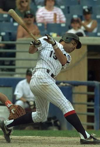 Chicago White Sox shortstop Ozzie Guillen hits a single in the fifth inning that streached into a two bases on an error Sunday, June 2, 1996, in Chicago. Two runs scored on the play in the second game of a double header. The White Sox defeated the Tigers 13-5.  <span class=meta>(AP Photo&#47;Michael S. Green)</span>
